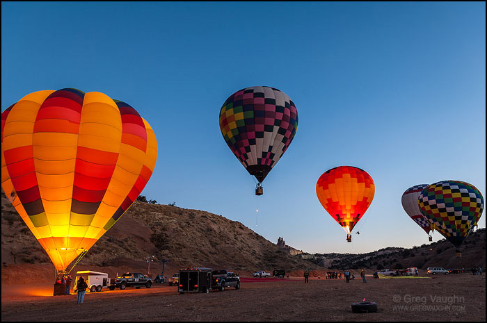 first balloons ascend at dawn from Red Rock Park