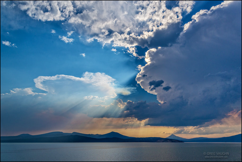 Thunderstorm clouds and wildfire smoke over Upper Klamath Lake in southern Oregon.